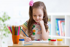 39038051 - cute preschooler child girl drawing pencil at home